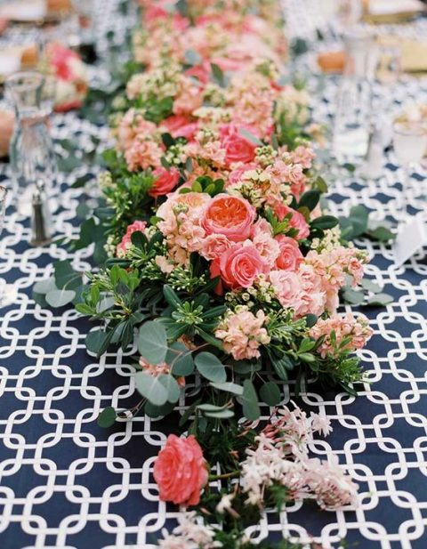 a lush greenery and pink and blush bloom table runner