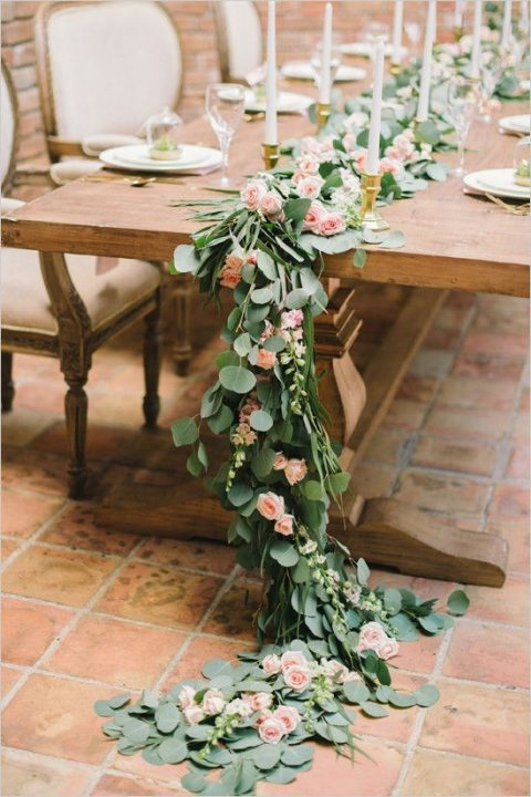 a lush greenery table runner with blush roses