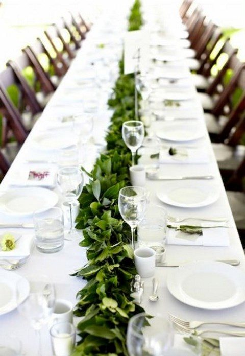 a lush greenery table runner with no blooms