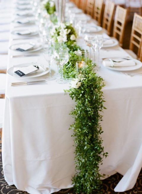 a textural greenery table runner with candles