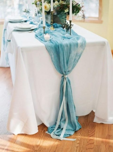 a watercolor blue table runner with a ribbon for a something blue touch