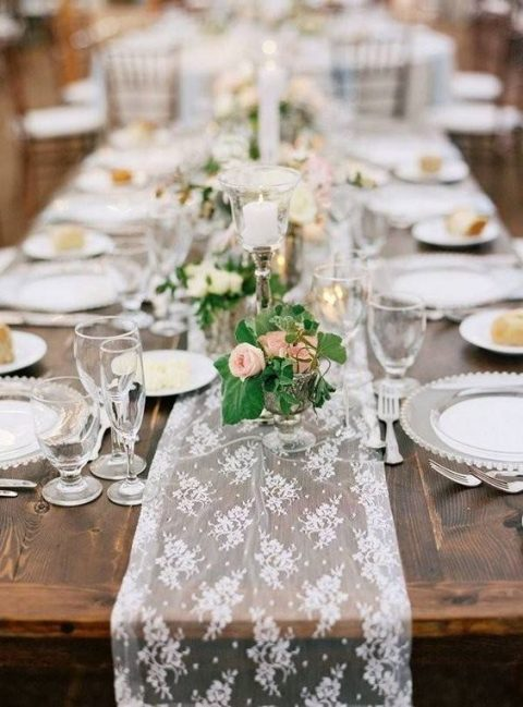 a white lace table runner for a chic rustic look