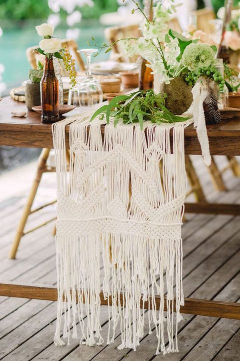 a white macrame table runner is ideal for a boho wedding