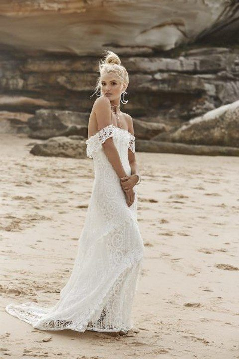 a boho lace off the shoulder A-line wedding dress with a train