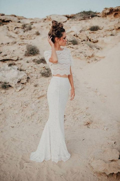 a chic lace ceparate with a lace crop top and a mermaid maxi skirt