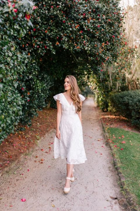 a cute midi dress with a ruffled V-neckline and lace appliques for a relaxed summer bride