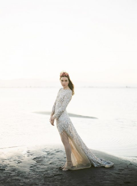 a gorgeous nude all-sparkling wedding dress all-covered with embellishments and pearls