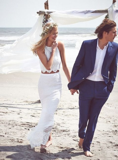 a lace bridal separate with a halter neckline crop top and a maxi skirt