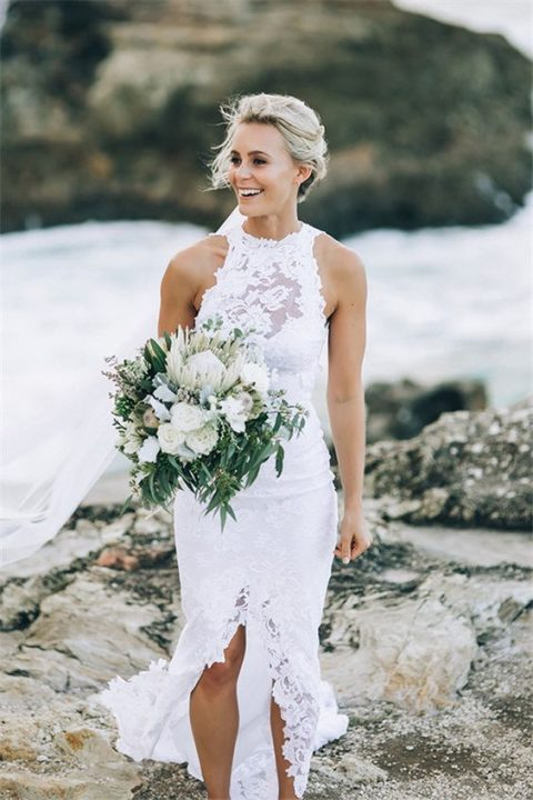 a lace illusion halter neckline wedding dress with a front slit