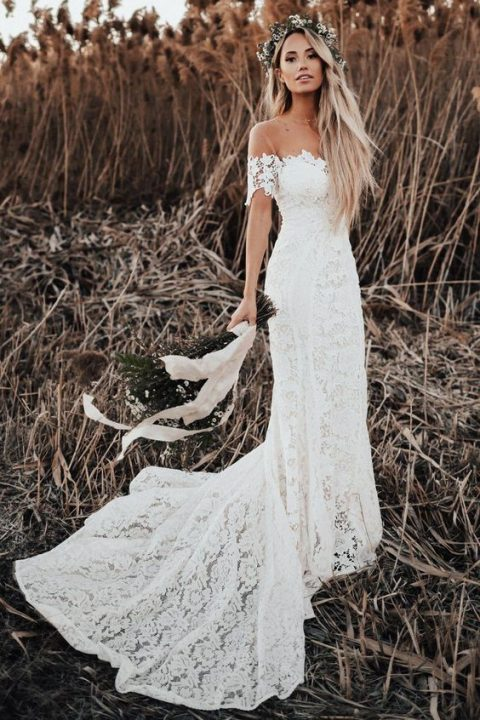 a lace off the shoulder wedding dress with a train looks very romantic