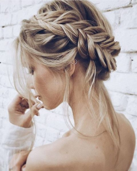a loose fishtail updo with locks down for a boho bride
