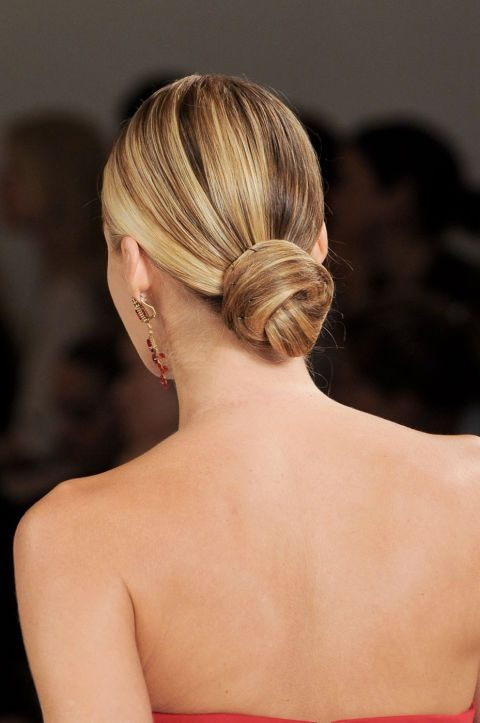 a low bun with a sleek top is a timeless option