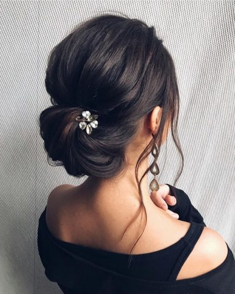 a low updo with a bump and locks down looks very elegant