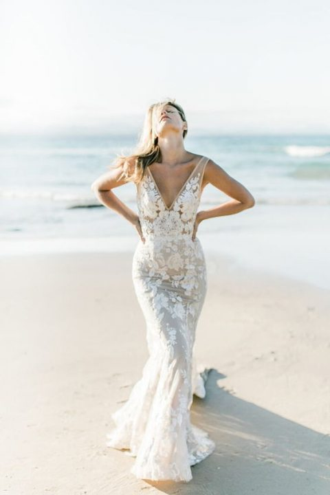 a mermaid lace applique sleeveless wedding dress with a deep V-neckline