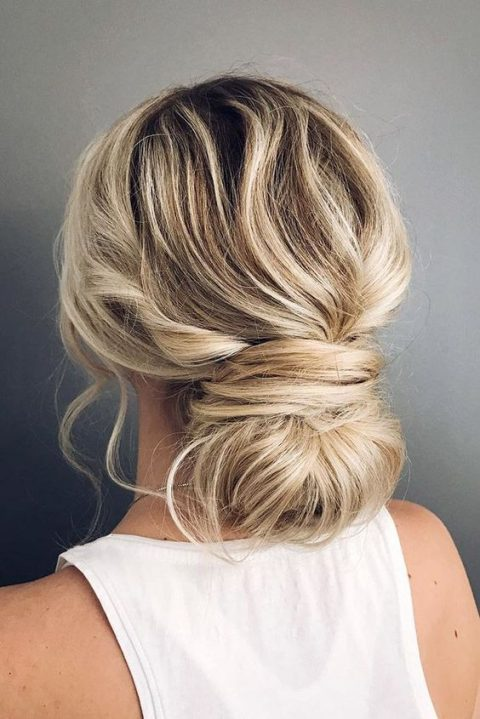 a messy low bun with a twist for those who have much hair