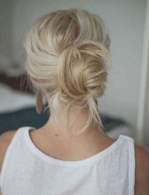 a messy low updo is great for medium hair and doesn_t require much time