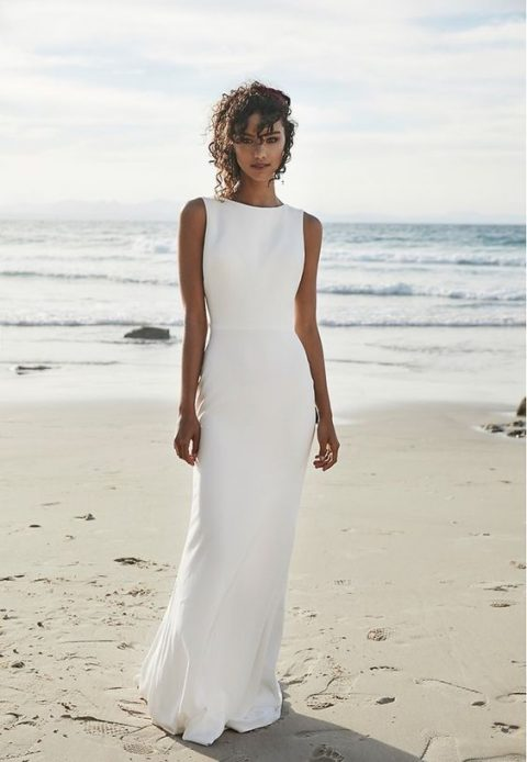 a minimalist white sheath dress with a high neckline and no sleeves
