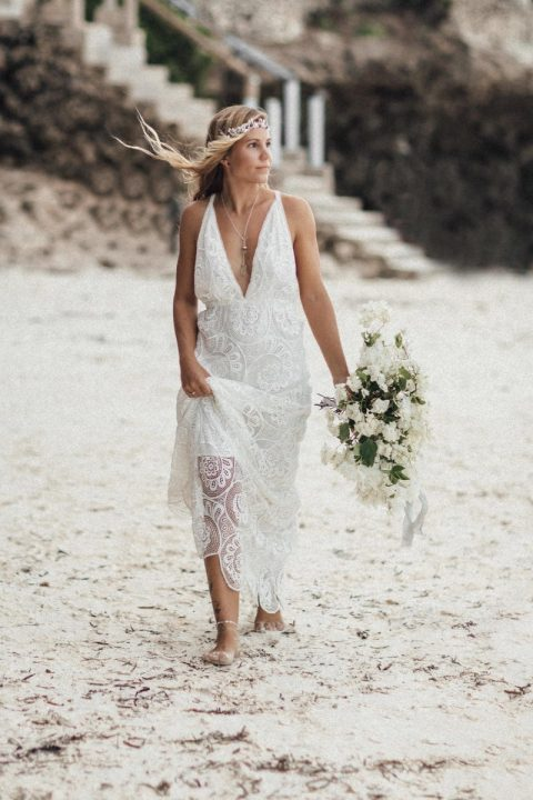 a relaxed boho lace wedding gown with a plunging neckline and thick straps