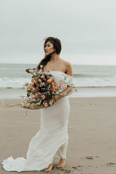 a simple off the shoulder wedding dress with a train for a boho feel