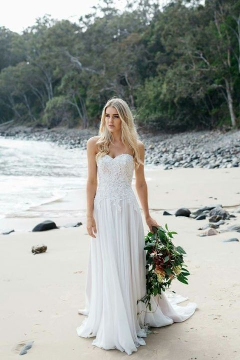a strapless A-line wedding dress with a lace bodice and a pleated skirt for a romantic bride