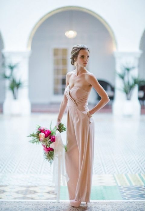 a strapless blush jumpsuit with a wrap bodice, wide pants and matching shoes