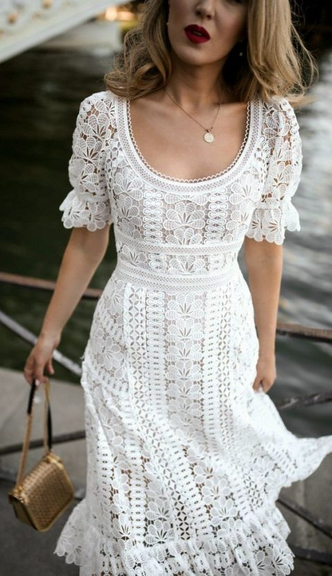a vintage-inspired ivory lace A-line dress with short sleeves, a scoop neckline and a midi skirt