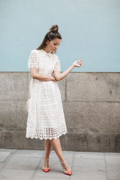 a white lace midi dress with short sleeves and a collar, coral studded shoes for a colorful accent