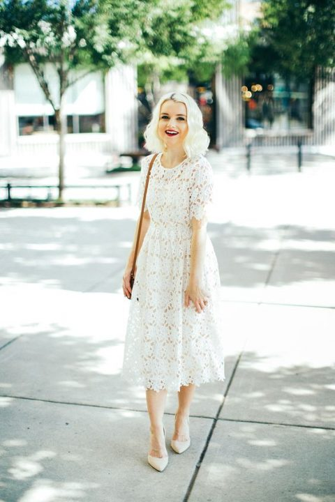 a white lace midi dress with short sleeves, light-colored shoes for a romantic feel