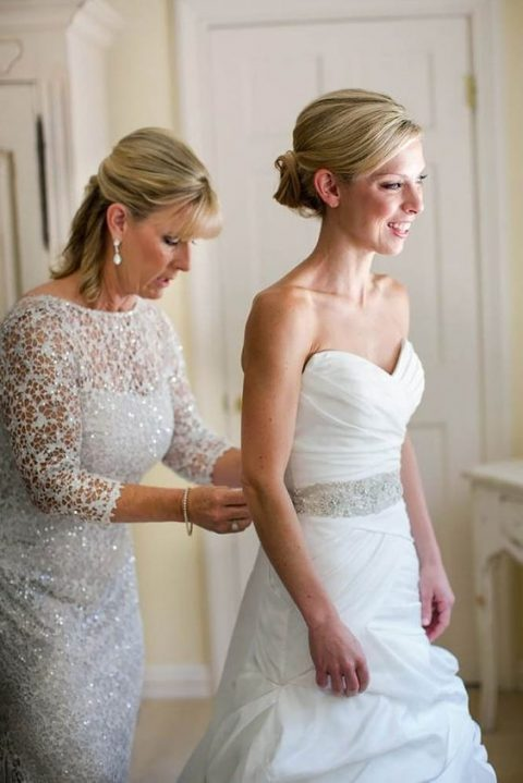 a white lace sparkling dress with long sleeves and an illusion neckline plus statement earrings