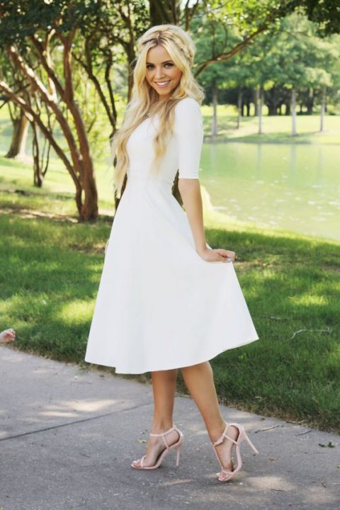 a white midi A-line dress with short sleeves, blush heels and a necklace for a girlish feel