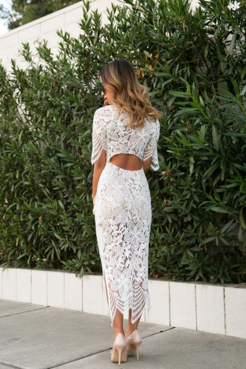 a white midi lace dress with short sleeves and a cutout back details for a wow look