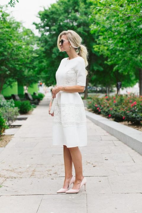 an elegant ivory dress with short sleeves and lace inserts plus blush heels