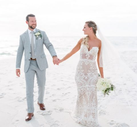 an illusion strapless mermaid wedding dress with no sleeves