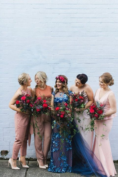 mismatched bridesmaids_ outfits including dusty pink jumpsuits