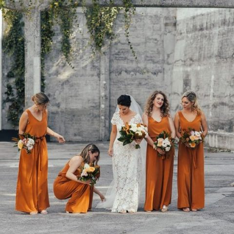 rust-colored jumpsuits for a fall wedding