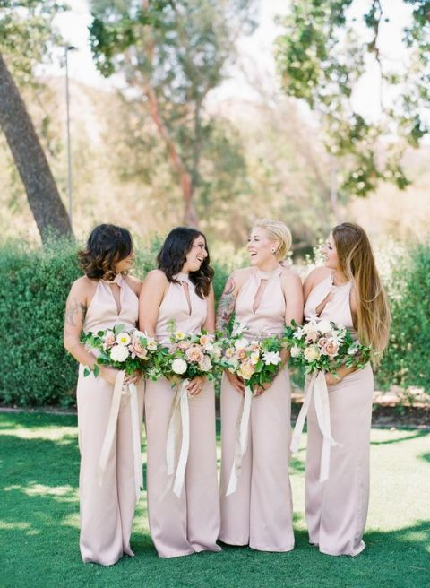 sexy blush jumpsuits with a halter cutout neckline and wide pants for a summer wedding