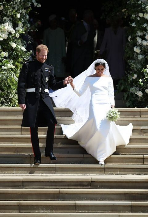 Meghan Markle rocking an off the shoulder wedding dress with long sleeves and an A-line skirt inspired everyone