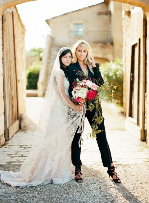 a black pantsuit, a black bra and black strappy heels for a gorgeous statement bridal look