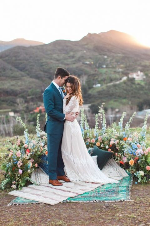 a boho bright wedding altar of colorful blooms with greenery