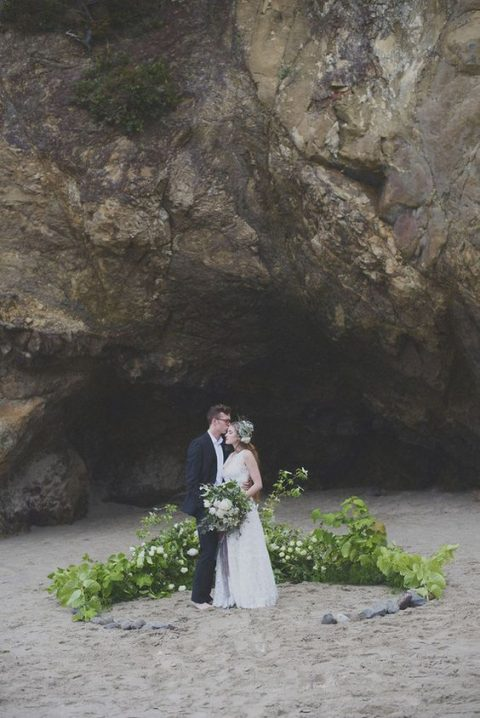 a greenery and white bloom wedding altar and a marching bridal bouquet