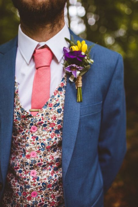 a grey slate suit, a colorful floral vest and a coral tie plus a white shirt for a summer groom