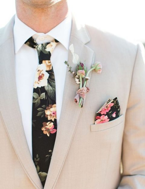 a neutral suit, a white shirt, a dark floral tie for a timeless feel