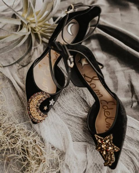 amazing black velvet heels with embellished stars and a moon for a celestial wedding