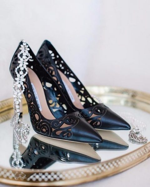black laser cut shoes by Manolo Blahnik