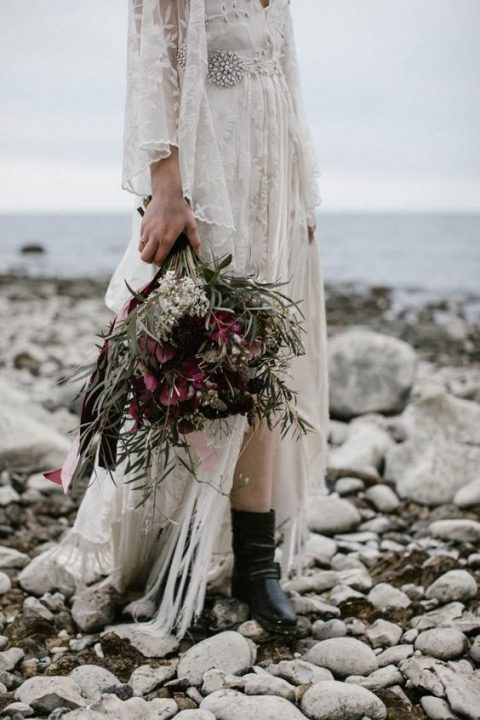black leather boots for a coastal boho bride - they guarantee comfort if the coast looks like that