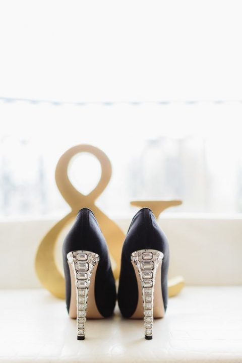 black shoes with fully embellished heels