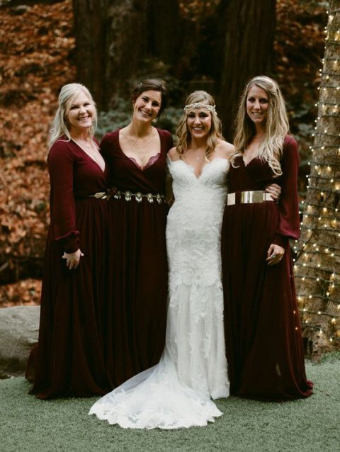 burgundy maxi dresses with long sleeves and different metallic belts for a woodland wedding