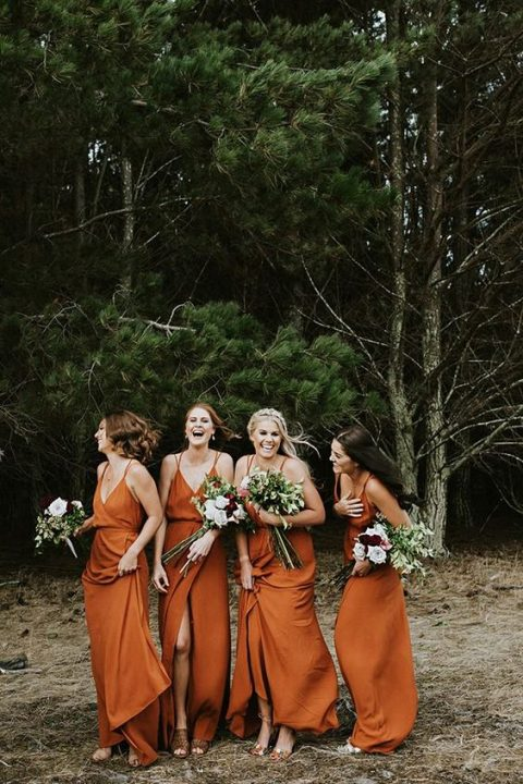 burnt orange bridesmaids_ dresses on spaghetti straps with front slits