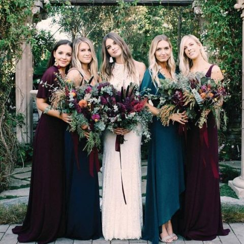 jewel-tone mismatched bridesmaids_ dresses in teal and plum with a different design