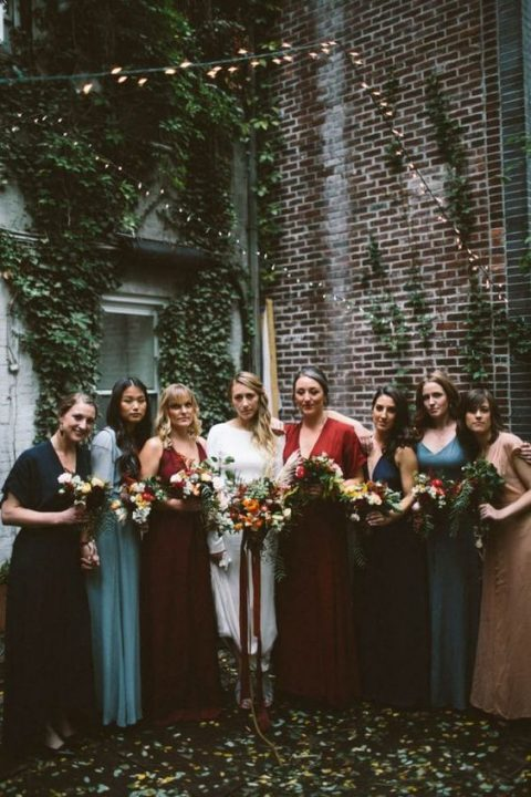 mismatched bridesmaids_ dresses in red, burgundy, blue, navy and nude
